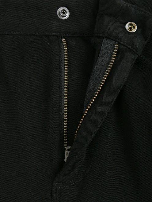 Брюки расклешенного кроя с карманами - Деталь1