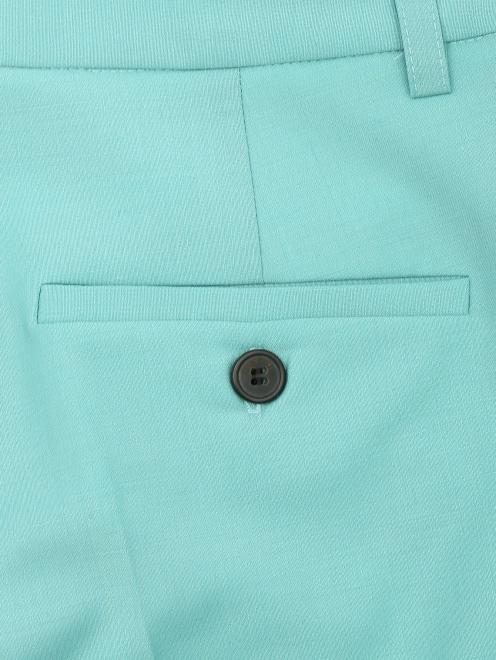 Укороченные брюки из шерсти со стрелками - Деталь