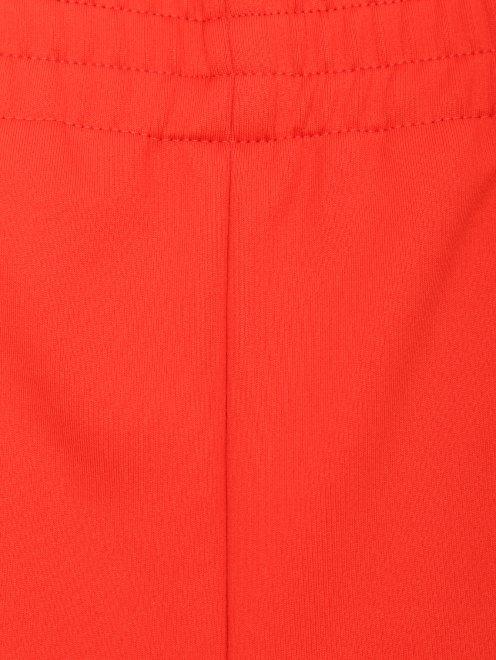 Узкие брюки на резинке с боковыми карманами - Деталь
